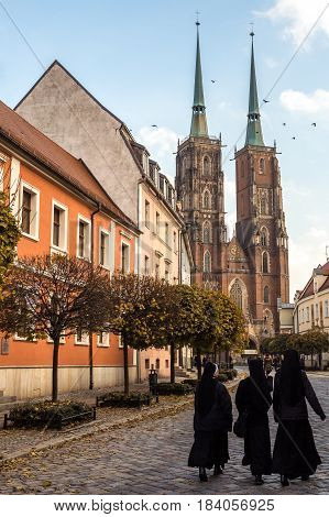 23rd October 2016: Three nuns walk down the road towards Wroclaw Cathedral Poland.