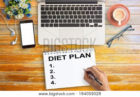Flat lay DIET PLAN healthy eating dieting slimming and weigh loss concept with laptopsmart phonecup of coffee and glasses on office desk. top view with copy space