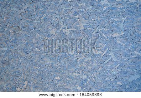 Soft pastel blue particle board compressed sawdust corkboard background