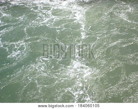 Waves from the boat grey aqutic sea ocean detail texture view