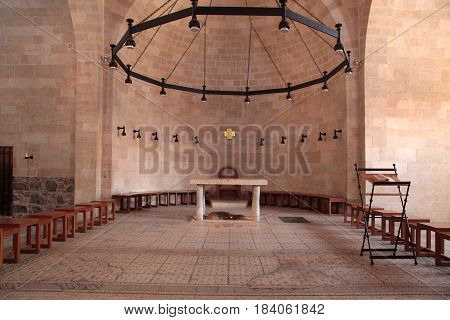 TABGHA, ISRAEL - AUGUST 30, 2015: Altar at the Church of the Multiplication, Tabgha near the sea of Galilee, Israel. This is believed to be the site where Jesus fed five thousand with five loaves and two fishes.