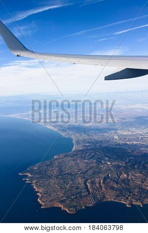 Leaving Los Angeles airport in an airplane LAX and flying over the pacific ocean on the way to NRT,JAPAN