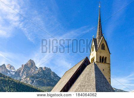 Italy Dolomites Pozza di Fassa the parish church bell tower