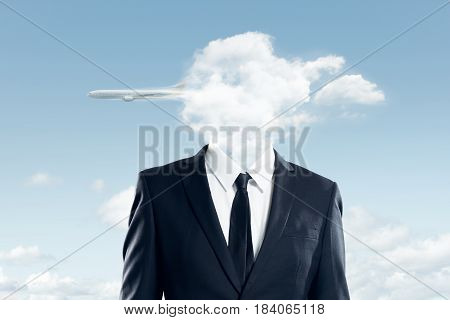 The head of the businessman is covered with clouds and the plane flew over the clouds business concept .