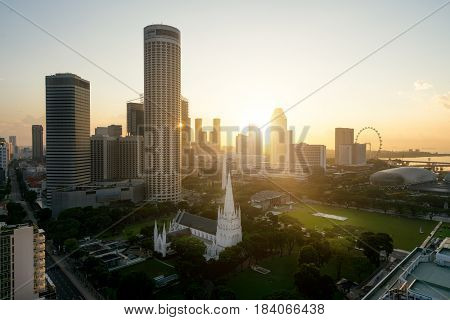 Sunrise at Singapore business district skyline and Singapore skyscraper with St. Andrew's Cathedral at Marina Bay Singapore.