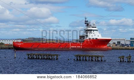 Edinburgh, Scotland, United Kingdom - April 27, 2017: Offshore tug/supply ship Volstad Supplier lies in the harbor of Edinburgh.