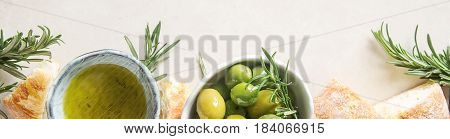 Olivier Oil With Fresh Herbs And Bread. Light Background. Italia