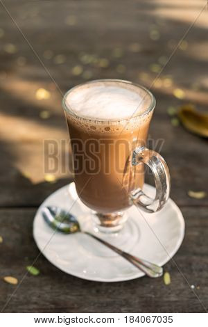 Mag of hot cocoa and foam on wooden table