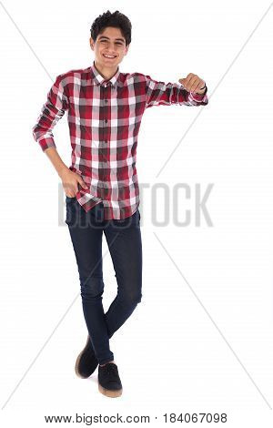 Full length portrait of smiley friendly teenage boy rising his arm and feelig happy teenager wearing red shirt and jeans isolated on white background
