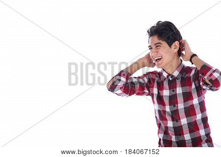 Happy teenage boy laughing and holding his head teenager looking side and wearing red shirt isolated on white background