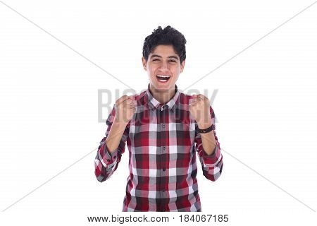 Satisfied smiley friendly teenage boy feeling success teenager wearing red shirt isolated on white background