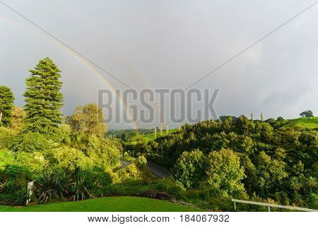 Double rainbow at Waitomo , North Island of  New Zealand
