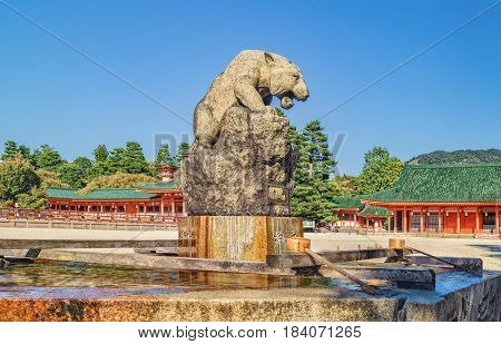 Stone Statue Of White Tiger Over Water Basin At Heian Shrine Heian Jingu In Kyoto, Japan