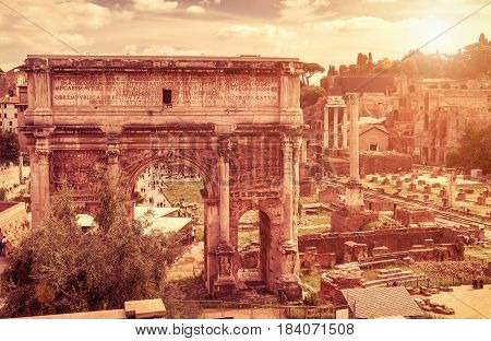 Ancient arch of Emperor Septimius Severus at the Roman Forum. Rome, Italy. The Roman Forum is one of the main tourist attractions of Rome.
