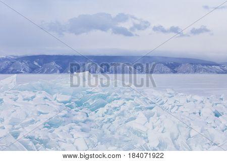 Winter Landscape. Turquoise Ice Floe. Baikal Lake Hummock
