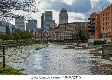 River lea near Bow looking towards Canary Wharf at low tide.