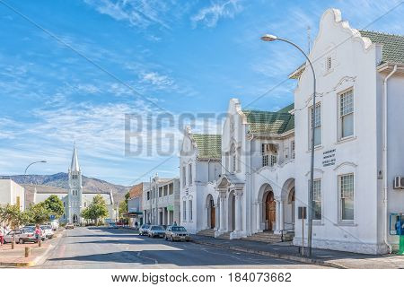ROBERTSON SOUTH AFRICA - MARCH 26 2017: A street scene with the municipal offices and Dutch Reformed Church in Robertson a town on the scenic Route 62 in the Western Cape Province