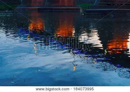 bridge night city reflected in water with lights and reflections. Uzghorod Uzhhorod