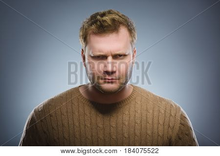 angry man isolated on gray background. Closeup.