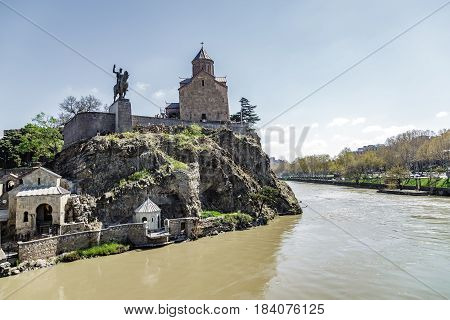 Monument to Tsar Vakhtang Gorgasal near the ancient fortress of the 13th century in Tbilisi Georgia. View from the Kura River. April 17 2015