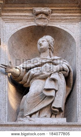 ROME, ITALY - SEPTEMBER 02: Saint Jeanne de Valois statue on the facade of Chiesa di San Luigi dei Francesi - Church of St Louis of the French, Rome, Italy on September 02, 2016.