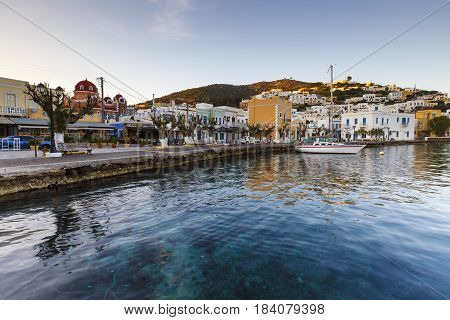 AGIA MARINA, GREECE - MARCH 25, 2017: Morning at the seafront of Agia Marina village on Leros island in Greece early in the morning on March 25, 2017.