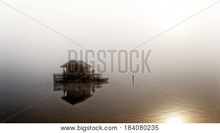 Houseboat on the lake early in the morning.