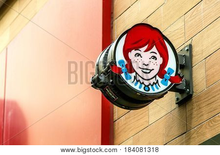 New York April 28 2017: The sign above an entrance to a Wendy's fast food restaurant in downtown Manhattan.