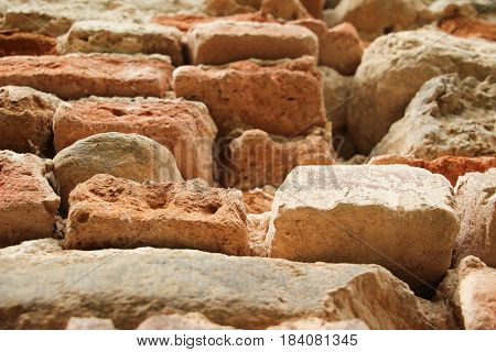 Ancient, old aged brick and stone wall. Aged photo look