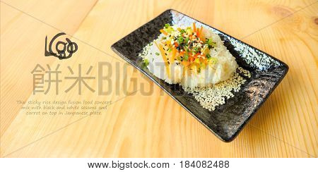 Macro photo focus select at Thai sticky rice food design has sesame and carrot on top ceramic plate, On wood, Japanese words meaning is sticky rice and mark guide is your logo.
