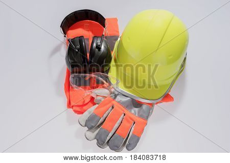 Standard construction safety equipment isolated with gloves, glasses and helmets