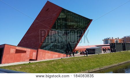 Gdansk, Poland - April 30, 2017: Building of the Museum of World War II from the outside. People watch the building.