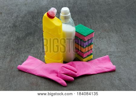 Cleaning Concept With Supplies Over Blackboard Background