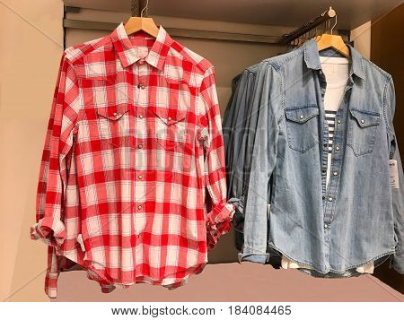 Cloth Hangers with fashion Shirts. Long sleeve shirts on hangers in a shopping mall