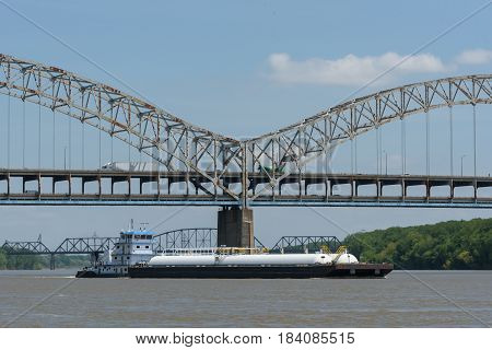 Barge passing beneather the Sherman Minton Bridge on the Ohio River in Louisville Kentucky