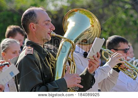 Volgograd Russia - May 08 2014: Musician in military uniform with trumpet takes part in Victory day event in Volgograd