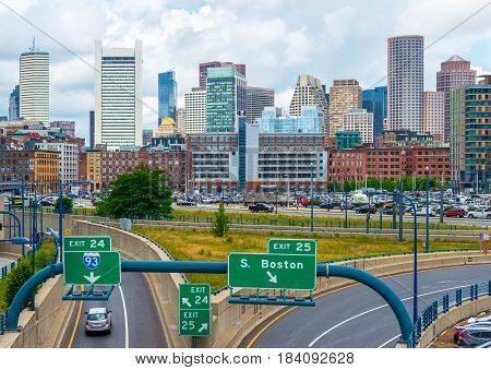 Boston - June 2016, USA: Boston skyline in summer day, view of downtown and highway with traffic