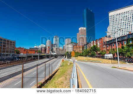 Boston - June 2016, USA: The street of Boston, view of John Hancock Tower surrounding buildings and highway with traffic, Back Bay district