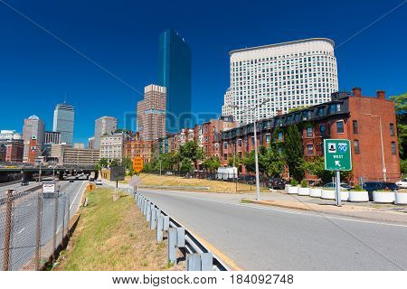 Boston - June 2016, USA: The street of Boston, view of John Hancock Tower, surrounding buildings and enter to the highway, cityscape against the blue sky