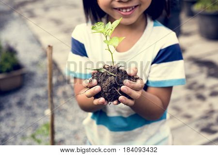 Child is holding plants