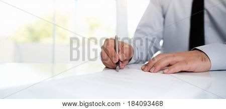 Businessman Signing An Official Document, Business Concept