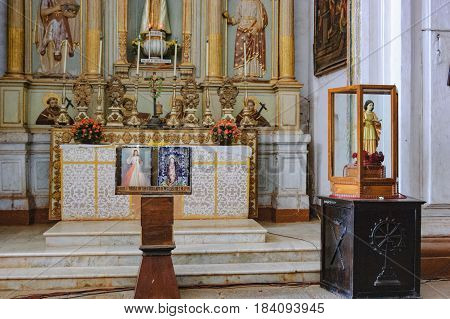 Old Goa, India - November 13, 2012: Interior of Catedral de Santa Catarina known as SE Cathedral - Roman Catholic church. Antique religious gilded bas-relief of saints