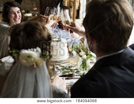 People Cling Wine Glasses on Wedding Reception with Bride and Groom