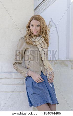 Beautiful Russian girl in a rural landscape