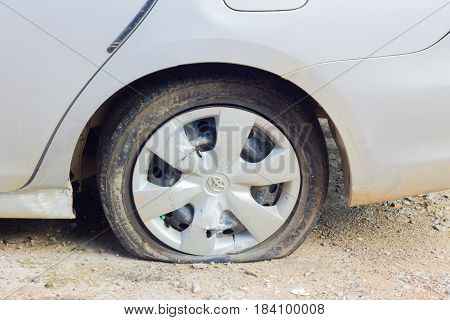 CHIANG RAI THAILAND - NOVEMBER 13 : flat tire of car on November 13 2014 in Chiang rai Thailand.