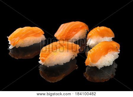 Japanese Sushi Nigiri Wijapanese Sushi Nigiri With Salmon Isolated On Black Background With Reflecti