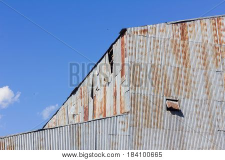 closeup old mill made of rusty galvanized iron background