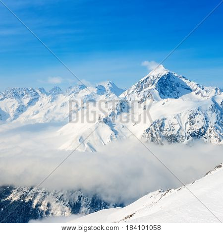 Beautiful Top Veiw Of Dombaj Mountains With Clouds And Valley, Close Up