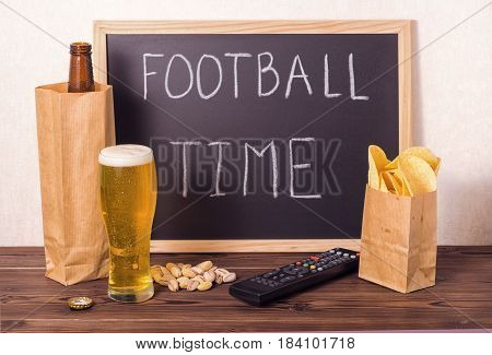 Football Fans Setting Of Beer Bottle In Brown Paper Bag,  Glass, Chips, Pistachio, Tv Remote Control