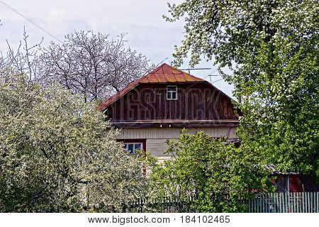 The part of the house in a flowered garden